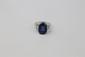 BAGUE en or gris et platine ornée d'un saphir Birman sans modification thermique de taille ovale d'environ 6 carats épaulé de deux diamants de taille baguette en chute. Poids brut : 8,1 g TDD : 46 Accompagnée de son certificazt du laboratoire
