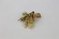 BROCHE en or jaune ciselée ornée de diamants de taille brillant Poids brut : 14,1 g