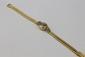 OMEGA MONTRE en or jaune, le bracelet deux rangs style tubogaz, la cadran épaulé de diamants de taille brillant. Poids brut : 24,1 g
