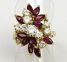 BAGUE en or jaune la monture stylisée et ornée  d'une succession de dix diamants de taille brillant et de onze rubis de taille navette. Poids brut : 8,4 g TDD : 52