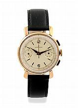 BREITLING  1940 Numéro : 785068 MONTRE chronographe en or jaune plaqué, le boitier rond,  le cadran ?, deux compteurs, index et chiffres arabes, règle télémètre rouge. Mouvement automatique à remontage. Diam : 33 mm
