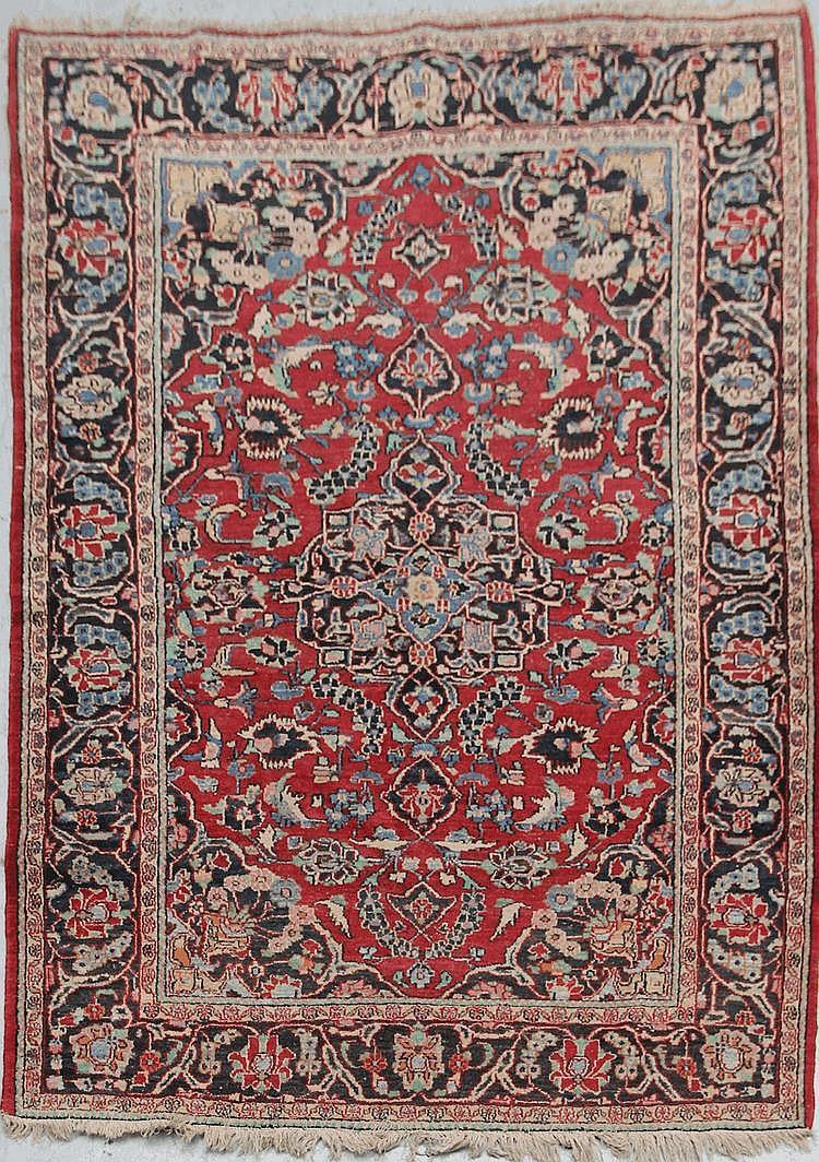KACHAN-AROUN (Iran) fond cerise à décor floral Milieu XXème siècle 194 x 134 cm