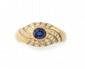 BAGUE en or jaune ornée d'un saphir de taille ovale en serti clos, la monture ajourée et pavée de diamants de taille brillant. Poids brut : 3,6 g TDD : 55  A sapphire, diamond and yellow gold ring