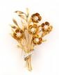 BROCHE en jaune stylisant un bouquet de fleurs ornée de diamants de taille brillant. Poids brut : 26,1 g Hauteur : 7 cm Largeur : 5,1 cm  Descendance de Marthe Régnier  A diamond and yellow gold brooch