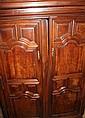 ARMOIRE en bois mouluré,sculpté et patiné ouvrant par deux portes pleines en façade. Elle est coiffée d'une corniche moulurée. Epoque XVIIIème siècle Haut : 220 cm  Long : 148 cm  Prof : 59 cm