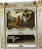 TRUMEAU A GLACE en bois peint et doré à pilastres latérales, et orné d'une huile sur toile dans un cartouche rocaille en partie haute. Haut : 163 cm  Larg : 143 cm  Prof : 8 cm