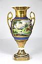 VASE en porcelaine de Paris à décor de paysages en médaillon sur fond bleu XIXème siècle H : 35 cm (monté en lampe, petit éclat au col)
