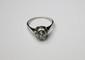 BAGUE en platine et or gris ornée d'un diamant de taille moderne Poids brut : 4,5 g TDD : 54 - 55