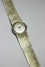 ETERNA MATIC Modèle SAHIDA MONTRE en or gris, le boitier réhaussé de diamants brillantés. Mouvement mécanique. Poids brut : 54,8 g