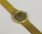 MONTRE en or jaune cadran rond entourage diamants.  Signée A.Barthelay. Poids brut : 52,2 g