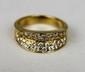 BAGUE en or jaune ornée de diamants de taille brillant. Poids brut : 5,7 g TDD : 53