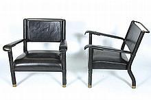 JACQUES ADNET (1900-1984)  Modèle du Paquebot Ferdinand de Lesseps, lancé en 1952, très légère variante Paire de fauteuils, formant chauffeuses, à structure métallique entièrement (re)garnie de cuir noir cousu à piqûres sellier.
