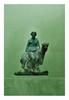 Rome, IIème siècle après J.-C.  MÉNADE tenant  une panthère. Bronze patine sombre.  Divers manques.  H. 18,5 cm.