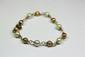 BRACELET en or jaune composé d'une alternance de perles de culture blanches et de perles d'or.Poids brut: 6,3 g