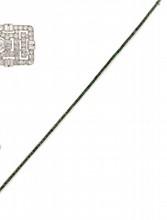 BRACELET ligne en or gris ornée d'émeraudes calibrés, la monture finement ciselée.    Poids brut : 12,1 g    Longueur: 18,5 cm         AN EMERALD AND WHITE GOLD BRACELET