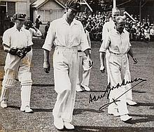 Autographed glossy B/w photo of Bradman leading