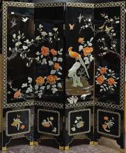 FOUR PANEL FOLDING SCREEN - Chinese black lacquer with applied hardstone representations of avian life and Flowers of the Four Seaso...