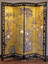 FOUR PANEL FLOOR SCREEN - Vintage Chinese black lacquer and gesso over wood with relief carved decorations on gilt ground in avian m...