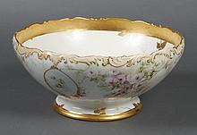 LARGE PORCELAIN T&V LIMOGE CENTER BOWL - Decorated with gold leaf, roses and putti. Painting attributed to Augusta Henrietta Knight ...