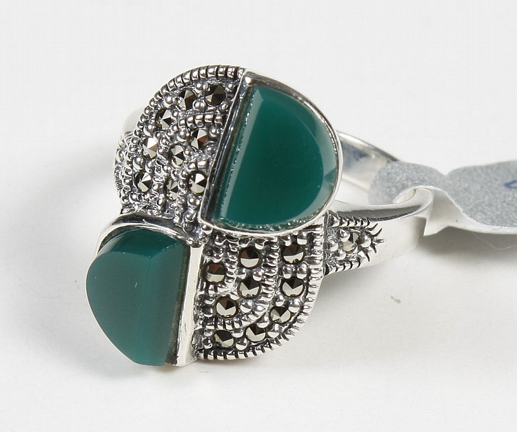 ART DECO RING WITH EMERALD AND TOPAZ - The sterling silver ring features two half-circles of dark unfaceted emerald, offset and surr...