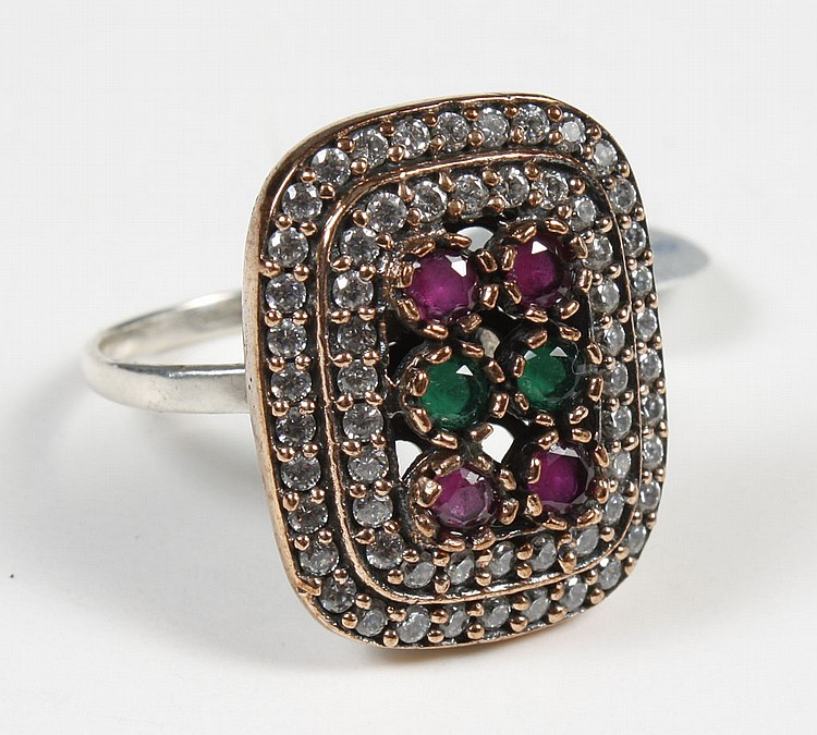 ART DECO RUBY AND EMERALD RING - Rectangular shape with two tiers of small brilliant cut clear sapphires surrounding