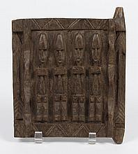 DOGON CARVED WOOD GRAINERY DOOR - Used to seal granaries and shrines; human figures carved in relief are shown on a panel of this do...