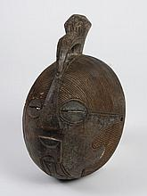 DEMOCRATIC REPUBLIC OF THE CONGO CARVED WOOD KUBA MASK - The wooden helmet mask is one of twenty different types of masks used among...