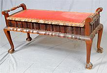 LIFT-TOP BENCH - Chippendale-style South African Stinkwood with upholstered top, turned carry handles, interior storage, shaped skir...