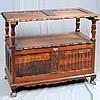 BISHOP'S BENCH - Chippendale-style South African stinkwood with convertible top, scalloped skirtings, lift-top central storage and c..