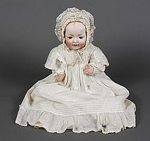16'' KESTNER BISQUE HEAD BABY DOLL - With brown sleep eyes; open mouth, 2 lower teeth and painted hair. Bent leg composition body. M.