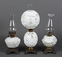 THREE KEROSENE MILK GLASS LAMPS - First, a double globe Gone with the Wind style. Lower milk glass font, molded flowers, spider webs...