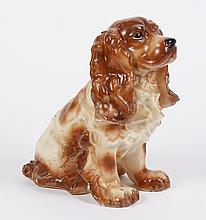 VINTAGE CAST PLASTER COCKER SPANIEL DOOR STOP - In a sitting position; brown and honey shades; wearing a collar with a heart dangle....
