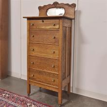 TALL DRESSER - Antique American oak with mirrored back rail and multiple storage drawers. Condition good; has been refinished. Late...