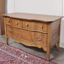 DRESSER - Antique American oak with two drawers and serpentine front configuration. Condition good; has been refinished. Late 19th c...