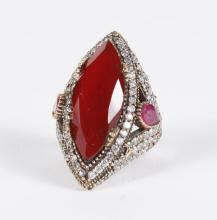 RED RUBY & WHITE TOPAZ SILVER RING - The elegant setting of sterling silver with bronze embellishment features a navette cut ruby (a...