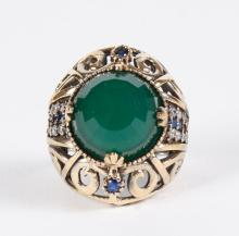 EMERALD & WHITE TOPAZ RING - A large spherical harlequin cut emerald is features on this sterling silver ring with gold bronze wash ...