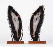 PAIR POLISHED GEODES - With dark outer rings, and a gray crystalline interior terminating in a green tinge