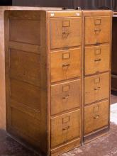 PAIR OF FILE CABINETS - Vintage American oak structurally combined pair, each with four legal sized file drawers, brass hardware and...