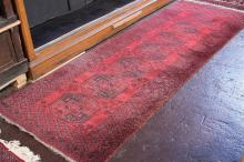 CARPET: HANDWOVEN AFGHANI TURKOMAN - All wool corridor carpet with single row of traditional 'elephant foot' guls in black and red o.