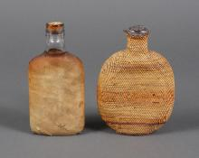 NORTHWEST TWINED BASKETRY BOTTLE AND HIDE COVERED BOTTLE - The first bottle has a tightly twined covering with faded color bands rem...