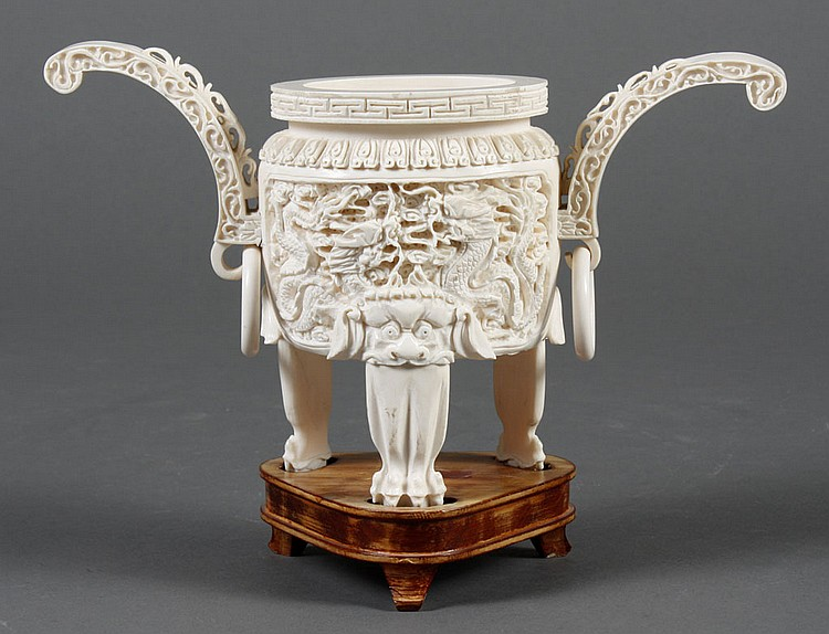 IVORY TRIPOD CENSER - Double handled with a double dragon motif. The censer is carved in several sections and assembled. On a fitted...