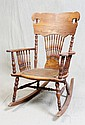 AMERICAN OAK ROCKING CHAIR - Pressed back American oak rocker with turned spindle supports to arms and back. Seat has inset of embos...