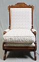 EASTLAKE UPHOLSTERED ROCKING ARMCHAIR - Eastlake style cherry rocking chair with carved and incised headrest and reeded detailing to...