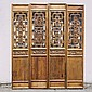 CHINESE CARVED PANELS - Four carved elm architectural panels incorporating many motifs; the center panel depicts birds, fruit, and f...