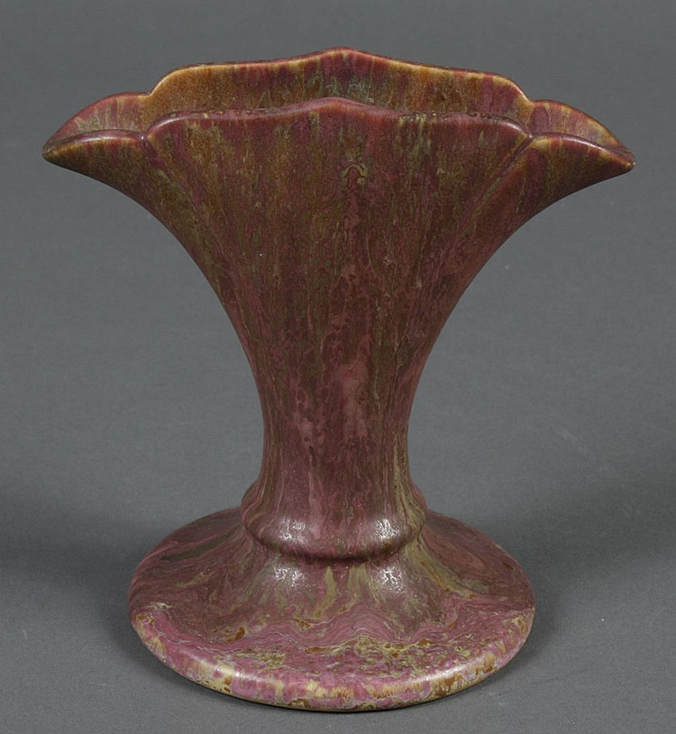 ROSEVILLE CARNELIAN VASE WITH BLACK FOIL LABEL - Fan shaped with irregular top; matte glaze with mottled rose and green coloration....