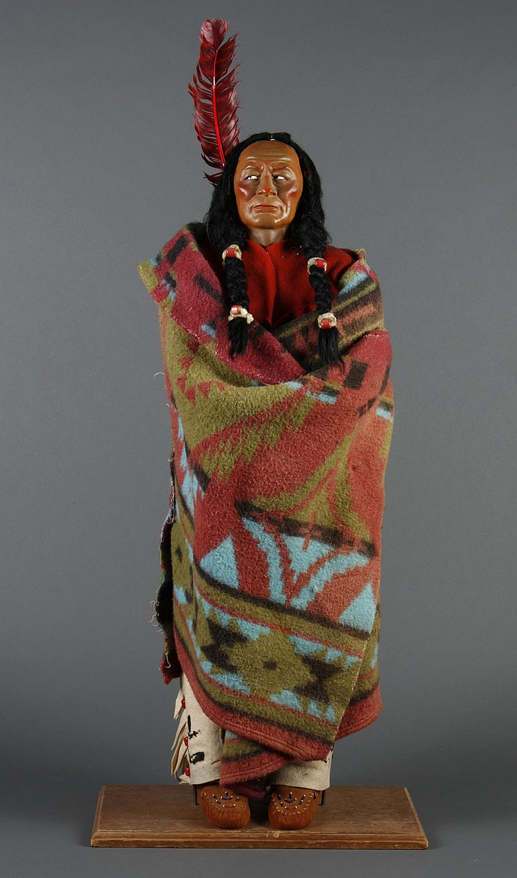 "34"" SKOOKUM DOLL TRADING POST DISPLAY - Native American male Skookum doll wrapped in a colorful blanket; painted plastic face and ey..."