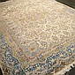 CARPET- HAND KNOTTED PERSIAN KIRMAN - Wool on cotton warp, cream field, central floral medallion, floral spray surround and multiple...