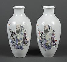 PAIR OF CHINESE PORCELAIN VASES - Having an ovoid form and short neck and depicting two of the Eight Immortals of Chinese mythology;...