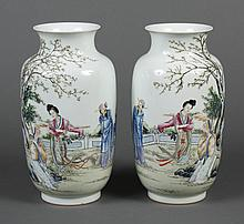 PAIR CHINESE PORCELAIN VASES - Four figures portrayed on rouleau form vases with a short flared neck; with scene portraying a young ...
