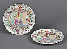 PAIR OF CHINESE PORCELAIN ROSE CANTON PLATES - Decorated in traditional style with figures of women in a courtyard and a border of f...